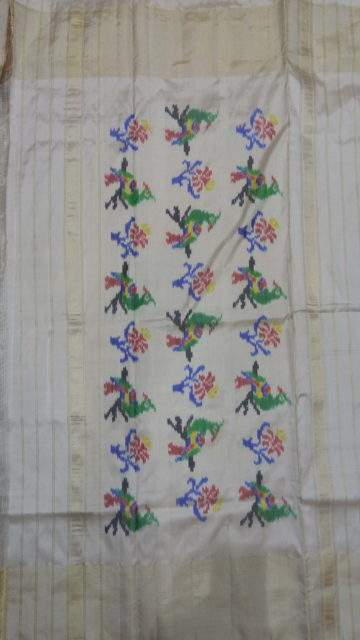Blue Blue and off-white Pochampally saree with peacock design