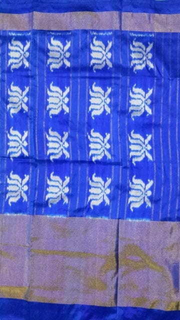 Blue ikat parrot green body with allover flowers blue color half tisuue saree