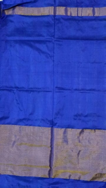 Shop ikat parrot green body with allover flowers blue color half tisuue saree Online