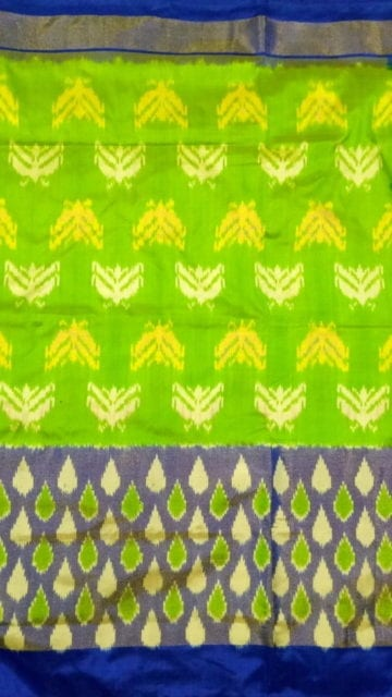 Yespoho ikat parrot green body with allover flowers blue color half tisuue saree