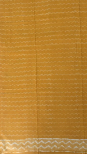 Shop Mustard Yellow wave pattern Dabu Mud Designer printed cotton saree. Online
